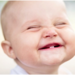 When Should My Child's First Tooth Erupt?